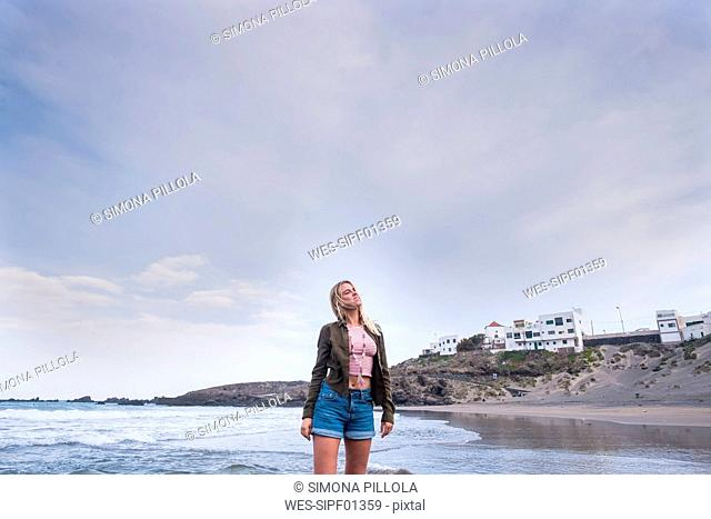 Spain, Tenerife, young blond woman on the beach
