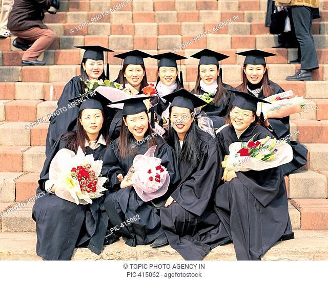 Graduates Posing Together