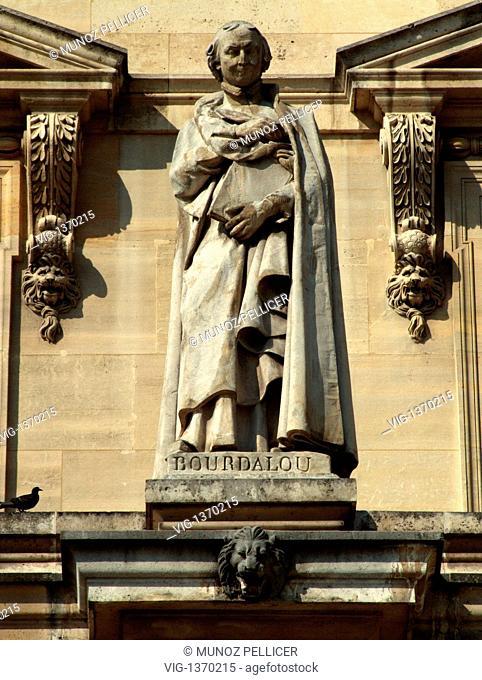 FRANCE, PARIS, 01.05.2007, Statue of French Jesuit and preacher Louis BOURDALOUE at the facade of The Louvre Museum - Palais Royal. Paris. France