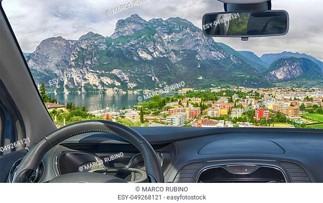 Looking through a car windshield with view of Riva del Garda, Lake Garda, Italy