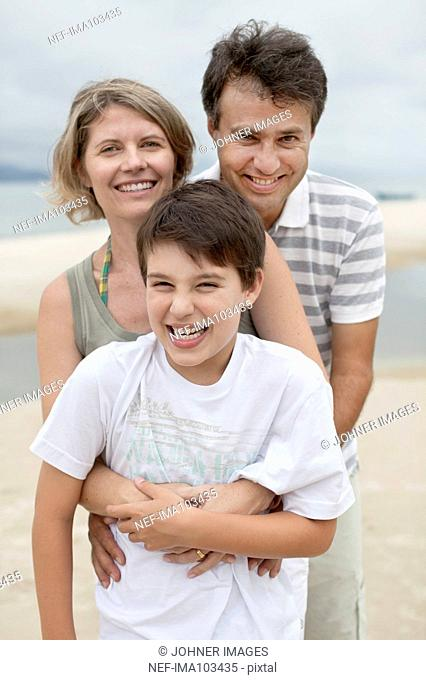 Parents with son on beach