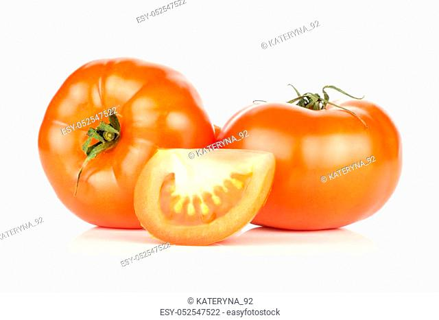 Two red tomatoes and one slice isolated on white background fresh