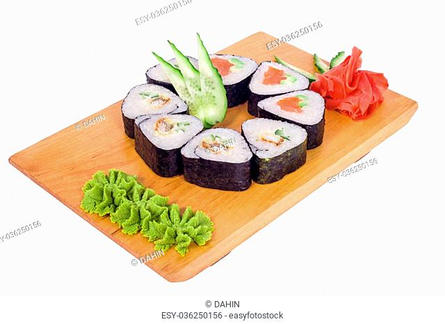 6 delicious sushi with red caviar and wasabi on a wooden tray