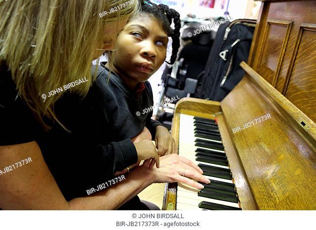 Piano lesson, Mysight Nottingham. Black visually imapired girl and teacher
