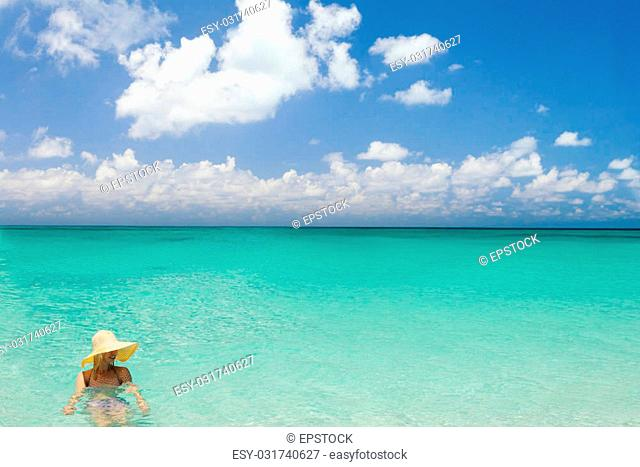 Woman swimming in a beautiful crystal clear Caribbean sea
