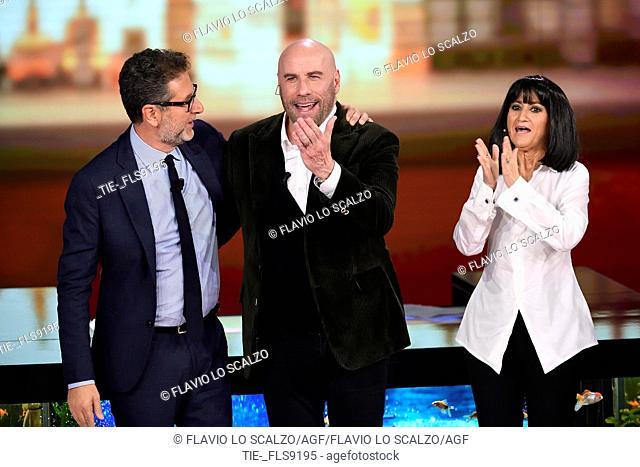 Tv conducer Fabio Fazio, actor John Travolta, Luciana Littizzetto during the tv show Che tempo che fa, Milan, ITALY-20-10-2019