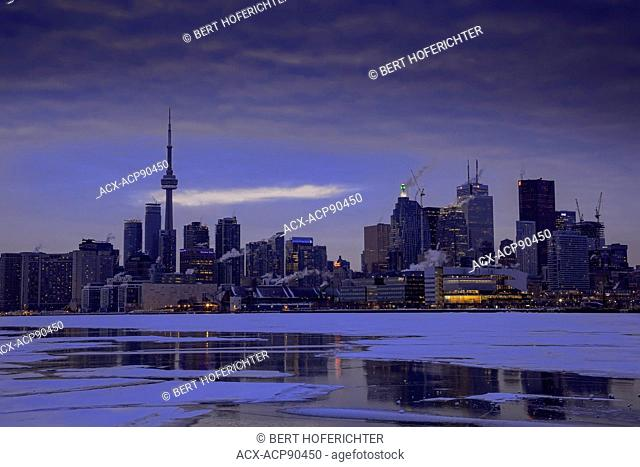 Winter and Sunset of Skyline and harbour of Toronto;Ontario;Canada,North America;and frozen Lake Ontario