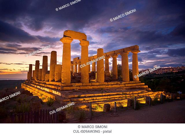 Floodlit Temple of Juno at dusk, Valley of the Temples, Agrigento, Sicily, Italy