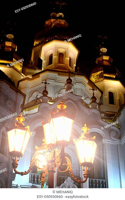 Church of the Holy Myrrh-Bearers of the Mirror stream. Kharkiv. Ukraine. Detailed photo of Church with golden domes and relief decors at night