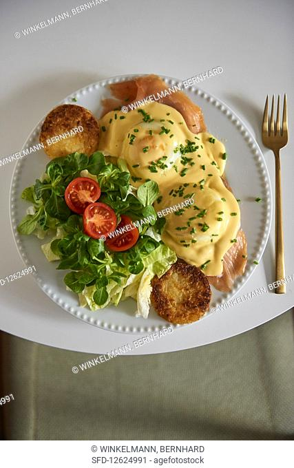 Eggs Benedict with potato fritters and lamb's lettuce