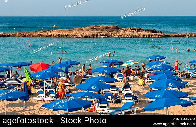 Tourists at famous Fig tree bay beach relaxing and enjoying their summer holidays on July 13, 2013 at Protaras area in Cyprus