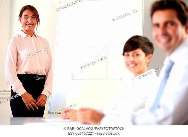 Portrait of a professional executive team smiling and looking at you on office