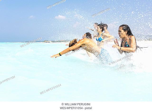 Friends having fun at the sea