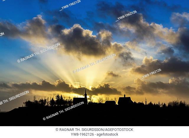 God rays over a church named Kotstrandarkirkja, Snaefellsnes Peninsula, Iceland