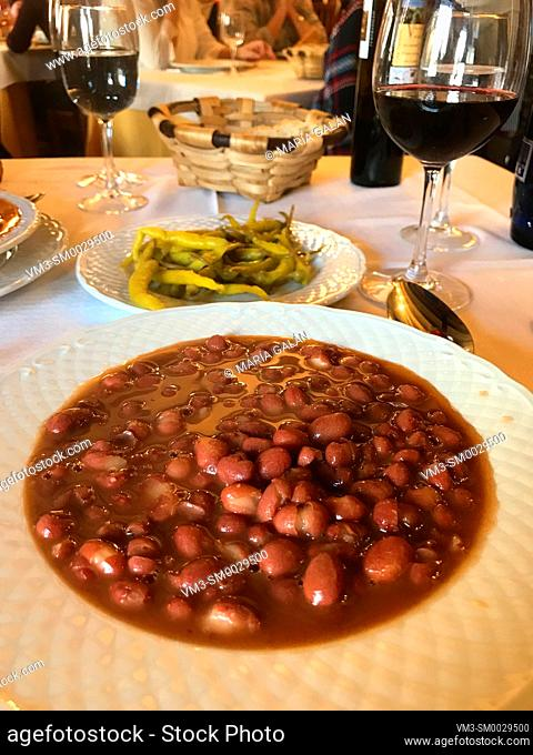 Olla podrida serving, traditional beans stew. Covarrubias, Burgos province, Spain