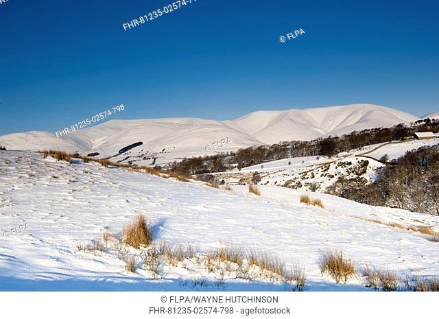 View of snow covered upland landscape, Eastern Howgills, from above Sedbergh, near Garsdale, Cumbria, England, winter