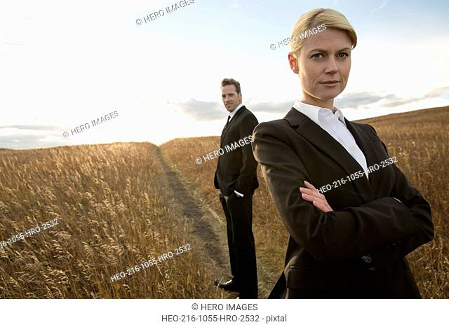 Portrait of confident business colleagues in field
