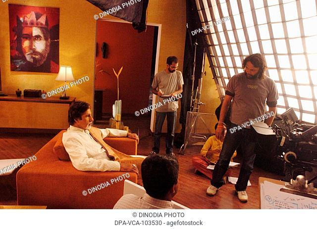 South Asian Indian Bollywood film star Amitabh Bachchan shooting for ad film in Mehboob studio ; Bombay Mumbai ; Maharashtra ; India