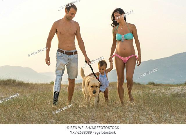 Handicapped father and family