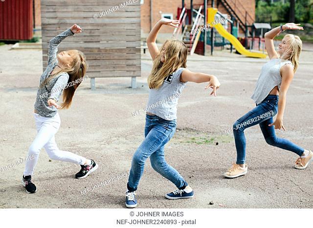 Girls dancing together
