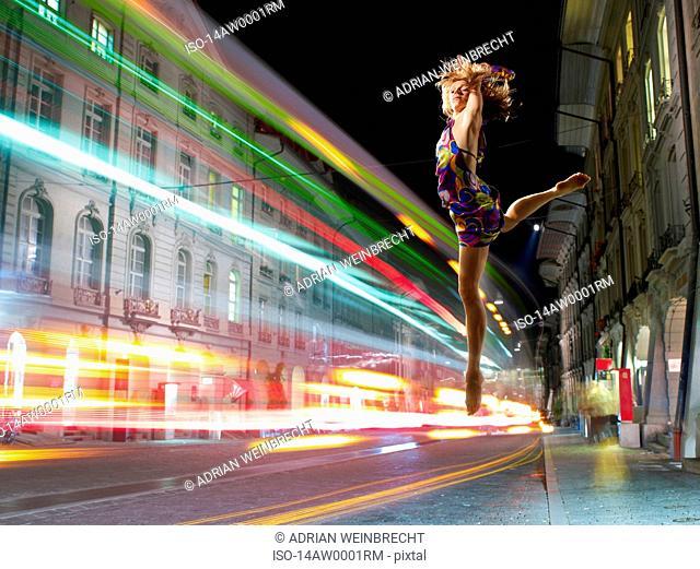 Woman dancer dancing in the streets
