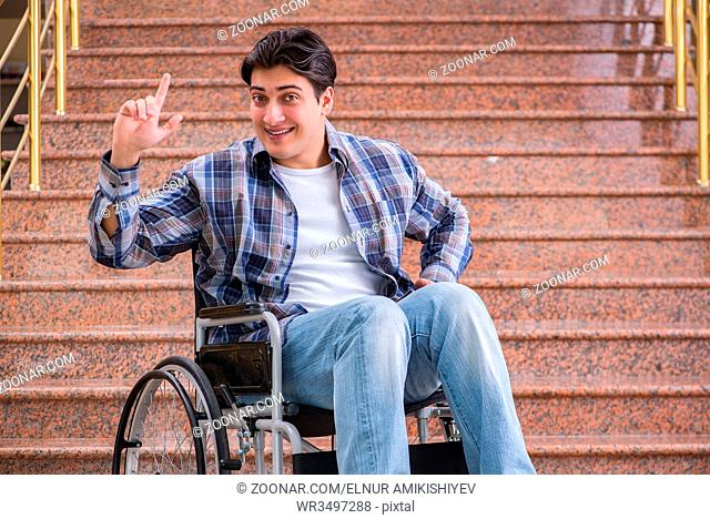 Disabled man on wheelchair having trouble with stairs