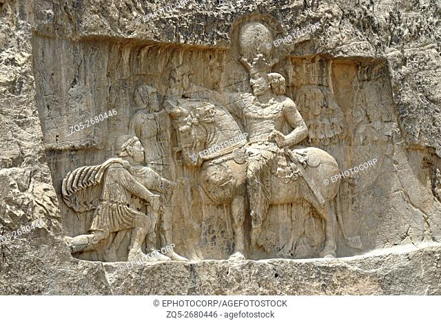 Naqsh e Rustam, Attendant bowing in front of the king on horse back, an archaeological site located about 12 km northwest of Persepolis, in Fars province, Iran