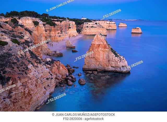 Cliffs along Praia da Marinha at Atlantic Ocean at sunset, Algarve, Portugal
