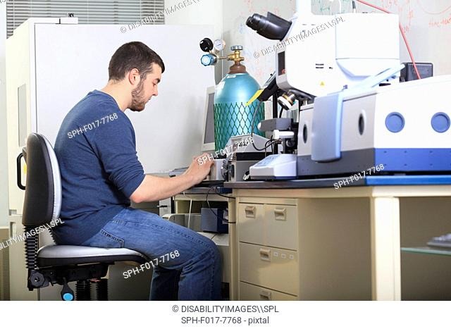 Engineering student reading the screen of chemical analysis equipment in a laboratory