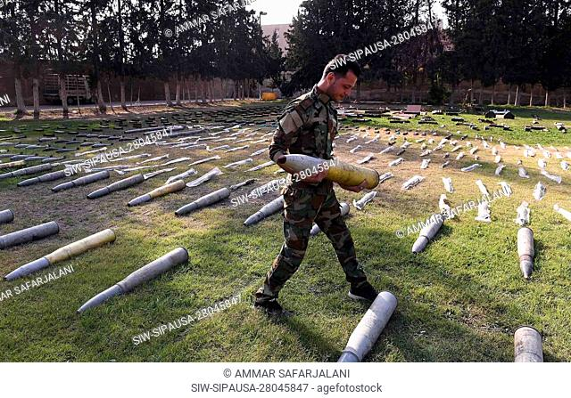(191107) -- DAMASCUS, Nov. 7, 2019 (Xinhua) -- A Syrian soldier shows confiscated weapons in a military site in Damascus, Syria, on Nov. 7, 2019