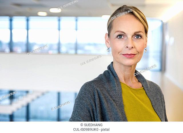 Portrait of confident mature businesswoman in office atrium