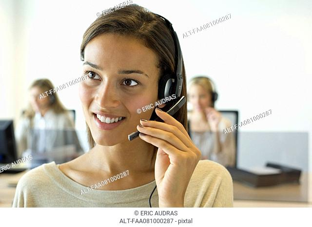 Woman using headset in office