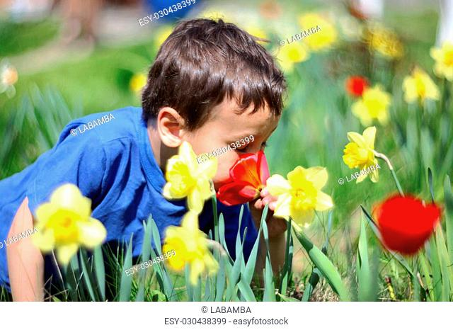 Smiling boy with a flowers