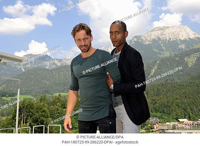 "24 July 2018, Schönau am Königsee, Germany: Actors Peter Marton (L) and Ben Blaskowic during a shooting break at the ARD series """"Watzmann ermittelt"""""