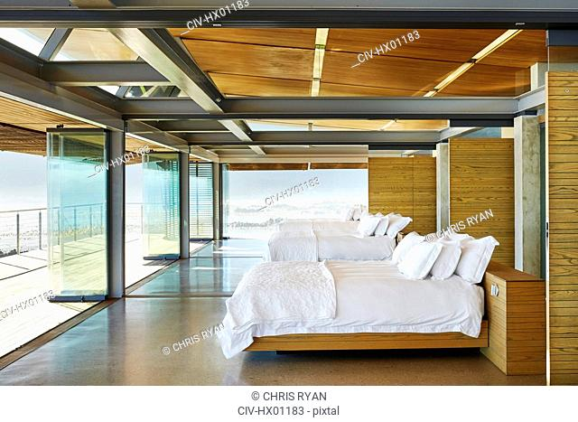 Modern hotel beds in a row open to patio