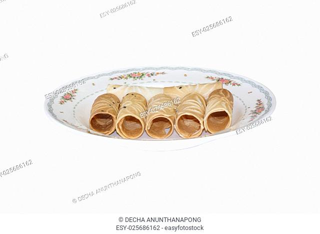 Tong Muan Rolled Wafer Thailand at the dish on white background