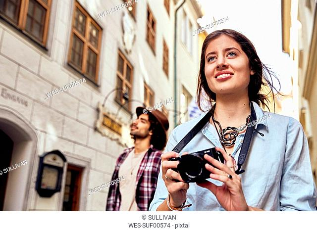 Young smiling woman taking a photo