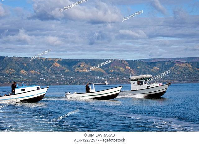 Men driving their wide-body boats in Kachemak Bay near Homer Spit, Southcentral Alaska, autumn