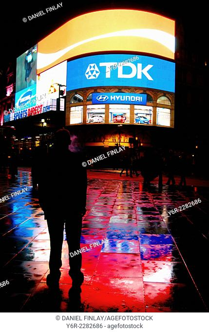 Piccadilly Circus, London, England, at night, after rain
