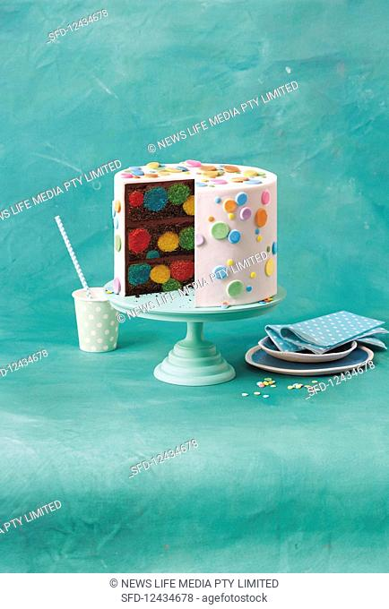 Devils Food Cake with polka dots, cut on cake stand