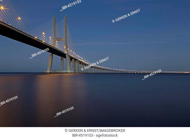 Vasco da Gama bridge over the Tagus river, dusk, Lisbon, Portugal