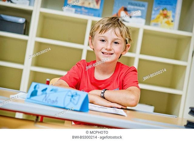 pupil sitting in the class
