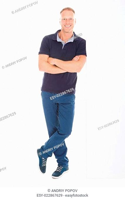 Man Standing Arms Crossed Over White Background
