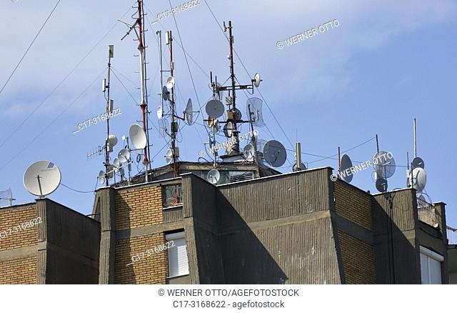 Novi Sad, telecommunications, broadcasting, television, radio, high-rise residential building, many receiving antennas on the rooftop of a multi-family house in...