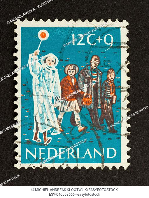 HOLLAND - CIRCA 1950: Stamp printed in the Netherlands shows children and a woman in traffic , circa 1950