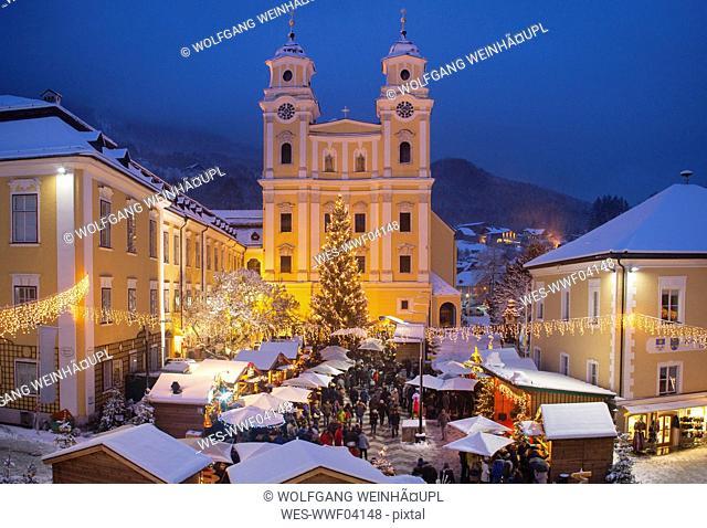 Austria, Salzkammergut, Mondsee, View of Basilica of St. Michael, christmas market at night