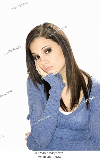 Very depressed Caucasian woman on a white background