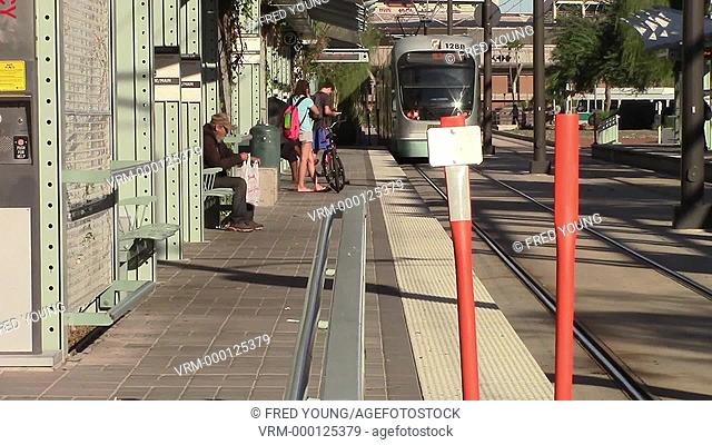 Tempe, AZ, USA - October, 6, 2014: Commuters disembarking the light rail trolley in downtown Tempe