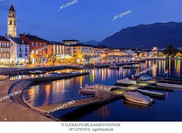 Ascona village's lights reflecting over Lake Maggiore, Canton Ticino, Switzerland