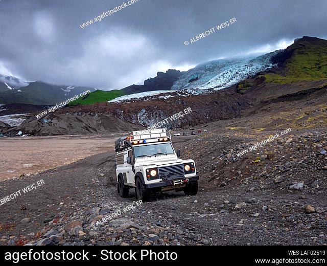 Man driving off-road vehicle at Svinafellsjokull, Iceland